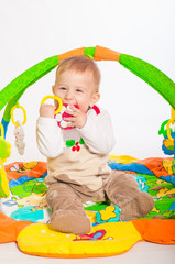 Baby boy playing with colorful toys