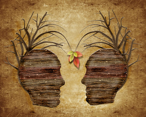 two wood human head and leaves