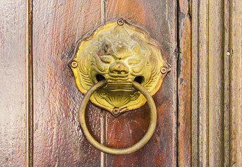 Old brass Chinese lion-headed door knocker