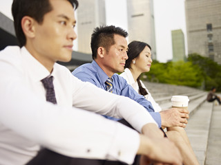 asian businesspeople looking depressed