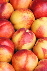 Background of ripe red nectarines closeup