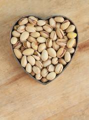 Pistachio nuts in heart shape