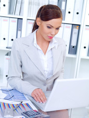 Stylish businesswoman working in an office