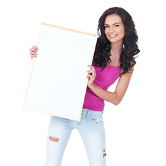 Attractive young student holding a blank sign