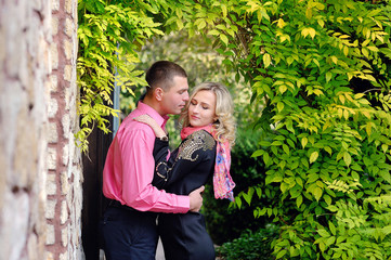 A happy young couple that is about to kiss.