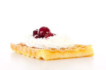 Brussels waffle with whipping cream and sour cherries