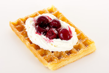 Waffle with cream and cherries