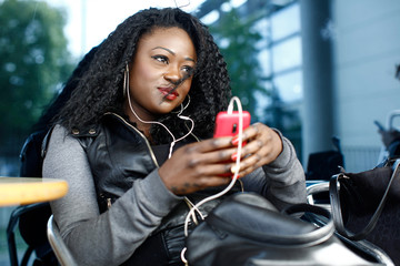 Trendy young woman relaxing listening to music