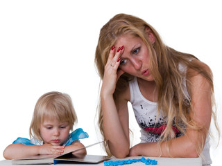Daughter with mother studying a book