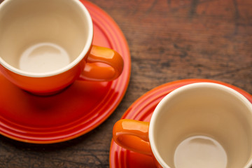 two stoneware coffee cups