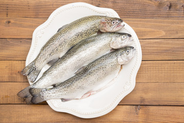 Trouts on a white plate