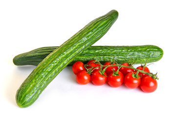 Red cherry tomatoes and green cucumbers