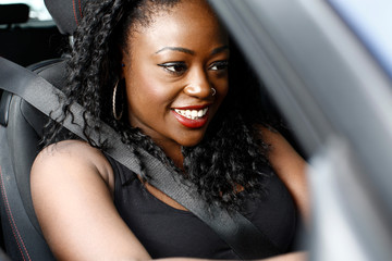 Attractive African woman driving her car