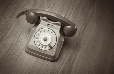 Vintage telephone on hardwood surface