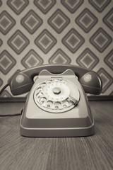 Vintage telephone on diamond wallpaper