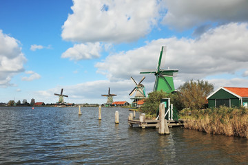 Four windmills on the banks of the channel