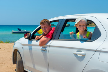 father and son went to the sea in a white car