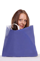 Cute woman in paper bag, with copy space