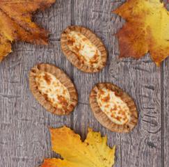 Traditional Karelian pasties on rustic wooden background