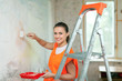 house painter paints wall