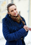 Smiling woman at wintry city