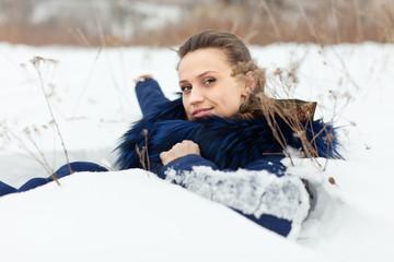 beautiful woman lying  on  snow