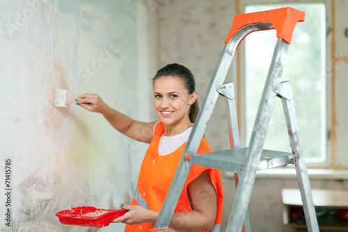 canvas print picture  house painter paints wall