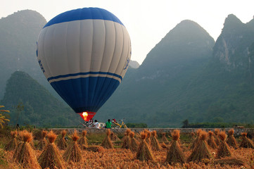 Hot air balloon among the hills and rice fields, Yangshuo, Guang