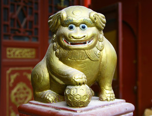 Ancient figurine of funny lion, decorative detail of chinese tao