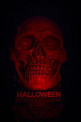 Close up of red skull with halloween text under