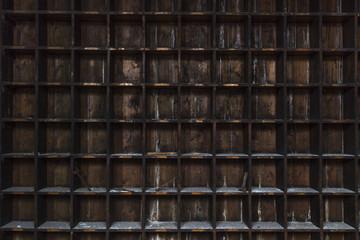 Old, distressed, dark wood storage shelves with random tools