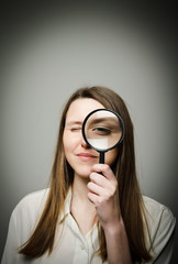 Woman with magnifier