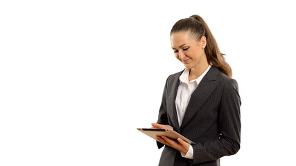 young beautiful businesswoman working on the tablet.