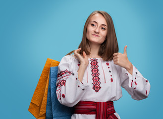 girl in the Ukrainian national dress and shopping bags