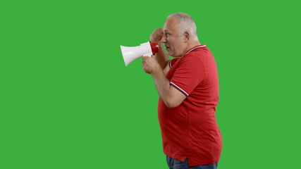 Senior man with megaphone on a grey background