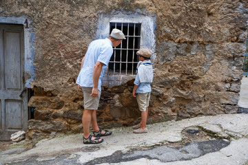 Father and his son in village Orgosolo, Italy