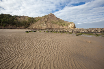 Textured sand and headlands at Cayton Bay