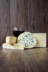 Cheese assortments on rustic wood