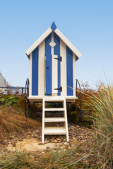 Portrait format blue striped beach hut with steps, Filey, UK