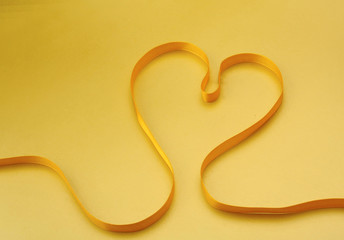 A yellow ribbon in the form of a heart