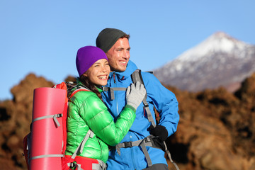 Campers couple hiking enjoying looking at view