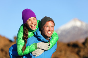Couple piggyback happy in active lifestyle