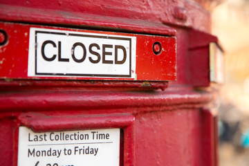 a closed red letterbox.
