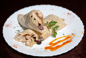 tortilla wraps with meat on wooden background
