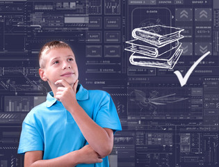boy thinks of his future, technology and school concept
