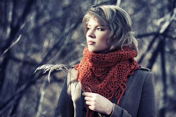 Young blond fashion woman in autumn forest