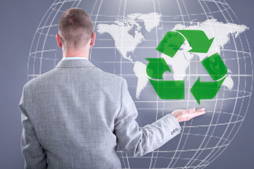businessman holding world Recycle
