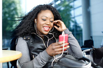 Happy Woman Talking Through Phone and Headphone