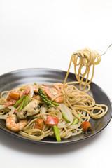 Stir fried spicy spaghetti with seafood