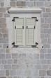 Window closed white shutters, Montenegro. close-up